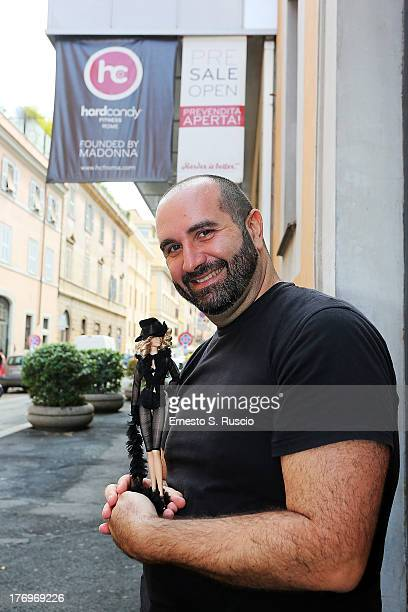 Dolls designer Alessandro Gatti attends the Madonna visit at The Hard Candy Fitness at Colosseo on August 20 2013 in Rome Italy