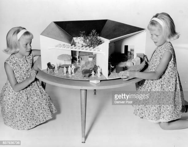 Dolls Doll Houses This doll house shown above with NBC's Paul twins revolves just like a motion picture stage bringing every room into view and...