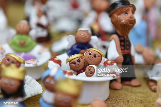 Dolls for sale at a trade stand of the 25th Bethlehem nativity doll Fair in Seville Spain Setting up a nativity scene at home is a popular tradition...