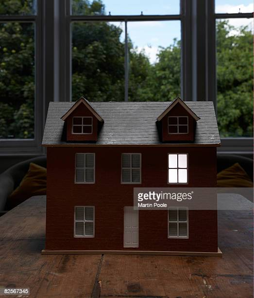 dolls house with light coming from one window