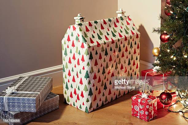 Dolls house wrapped as Christmas present