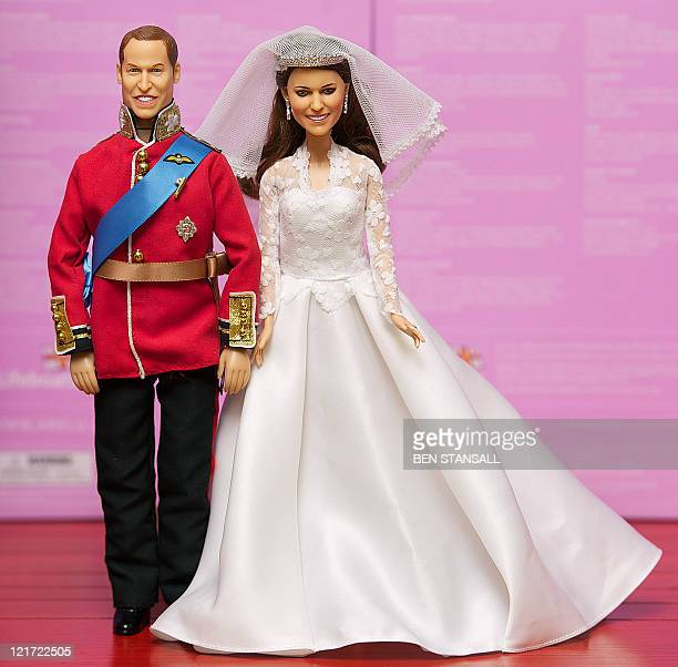 Dolls modelled on Britain's Prince William and Catherine the Duchess of Cambridge on their wedding day are pictured at Hamleys toy store in central...