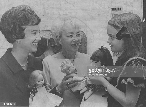 NOV 28 1967 NOV 30 1967 DEC 3 1967 Dolls of three generations are shown by Mrs William Kuhn left 431 Elm St her mother Mrs Henry Hough center 348...