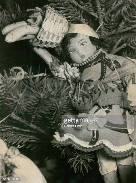Dolls Present Ethnic Christmas Two hundred dolls dressed in costumes from around the world have been used to decorate two Christmas trees currently...