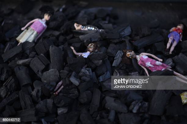 Dolls representing the 29 victims of a fire at governmentrun children's shelter in San Jose Pinula east of Guatemala City are seen amid a pile of...