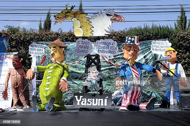 Dolls representing the oil exploitation in the Yasuni zone are paraded in Quito on December 31 2013 during the traditional competition of dummies...