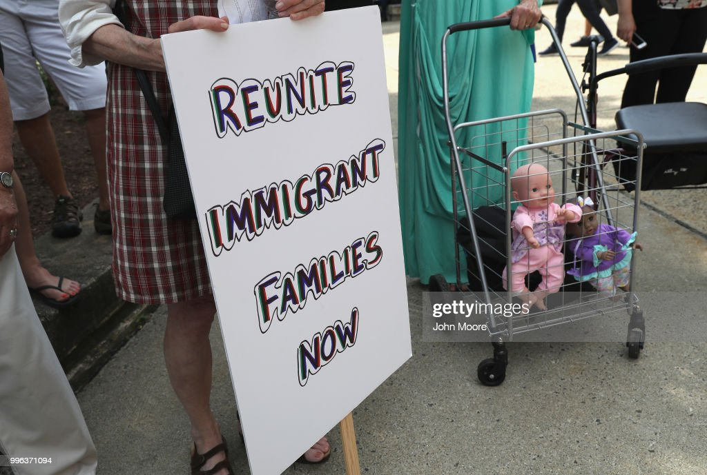 Dolls stand in a shopping cart as protesters rally against the separation of immigrant families in front of a U.S. federal court on July 11, 2018 in Bridgeport, Connecticut. The rally was in support of two Central American children separated from their parents as a result of the Trump administration's 'zero tolerance' policy on undocumented immigration at the southern border. The two children, who are reportedly being held in a facility in Groton, CT were to appear at a court hearing ahead of possible reunification with their parents.