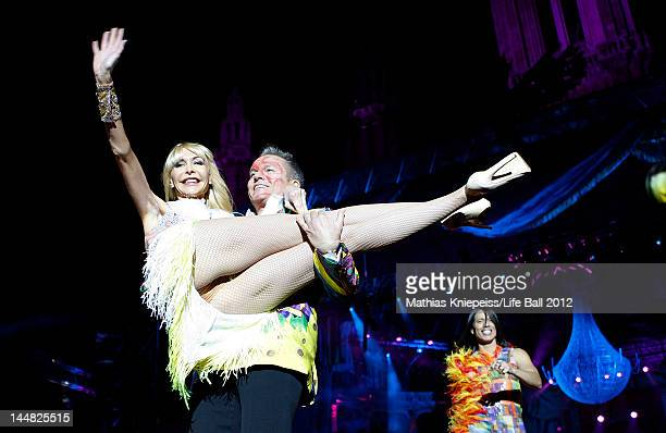 Dolly Buster and Alfons Haider are seen on the catwalk at the Life Ball 2012 AIDS charity fundraiser at City Hall on May 19 2012 in Vienna Austria
