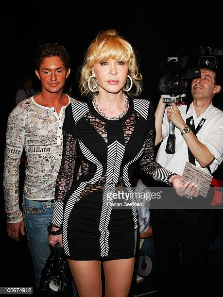 Dolly Buster and boyfriend Tim arrive at the Lena Hoschek Show during the Mercedes Benz Fashion Week Spring/Summer 2011 at Bebelplatz on July 7 2010...