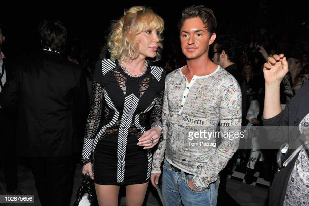 Dolly Buster and boyfriend Tim pose in front row at the Lena Hoschek Show during the Mercedes Benz Fashion Week Spring/Summer 2011 at Bebelplatz on...