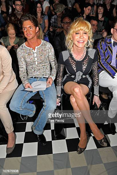 Dolly Buster and boyfriend Tim sit in front row at the Lena Hoschek Show during the Mercedes Benz Fashion Week Spring/Summer 2011 at Bebelplatz on...