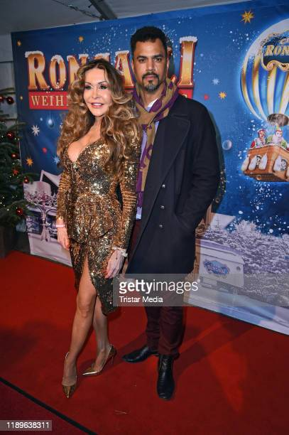 Dolly Buster and Patrice Bouedibela attend the 16th Roncalli Weihnachtscircus at Tempodrom on December 19 2019 in Berlin Germany