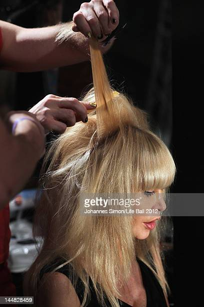 Dolly Buster lets do her hair during the backstage preparations of the Life Ball 2012 AIDS charity fundraiser at City Hall on May 192 012 in Vienna...