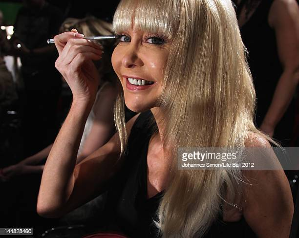 Dolly Buster puts her eye make up during the backstage preparations of the Life Ball 2012 AIDS charity fundraiser at City Hall on May 192 012 in...