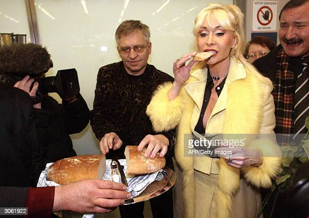 OUT== Dolly Buster the Czechborn German porn star whose real name is Katerina Bochnickova aka Nora Bamberger in Germany is greeted with bread and...