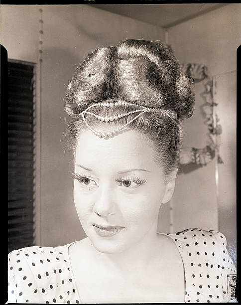 Profile Of Woman W Pompadour Hairstyle Pictures Getty Images