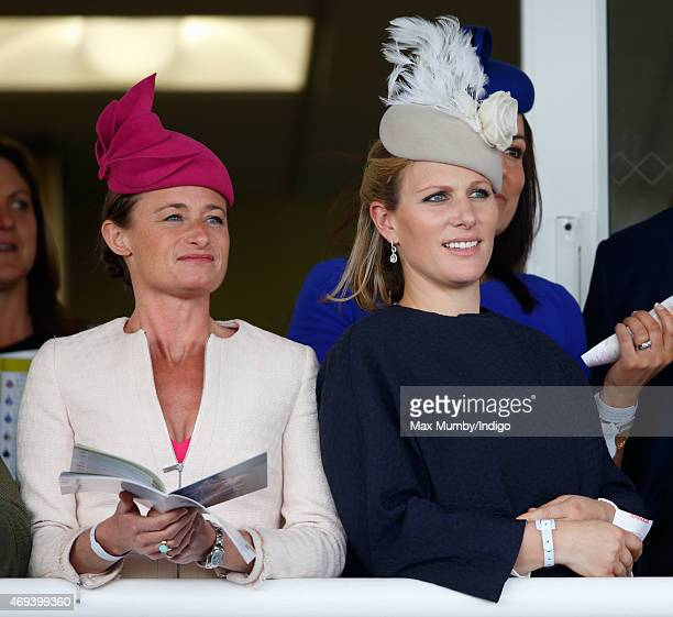 Dolly Maude and Zara Phillips watch the racing as they attend day 3 'Grand National Day' of the Crabbie's Grand National Festival at Aintree...