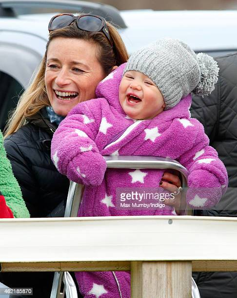 Dolly Maude carries Zara Phillips's daughter Mia Tindall as they attend the Heythrop Hunt PointtoPoint horse racing meet at Cocklebarrow Racecourse...