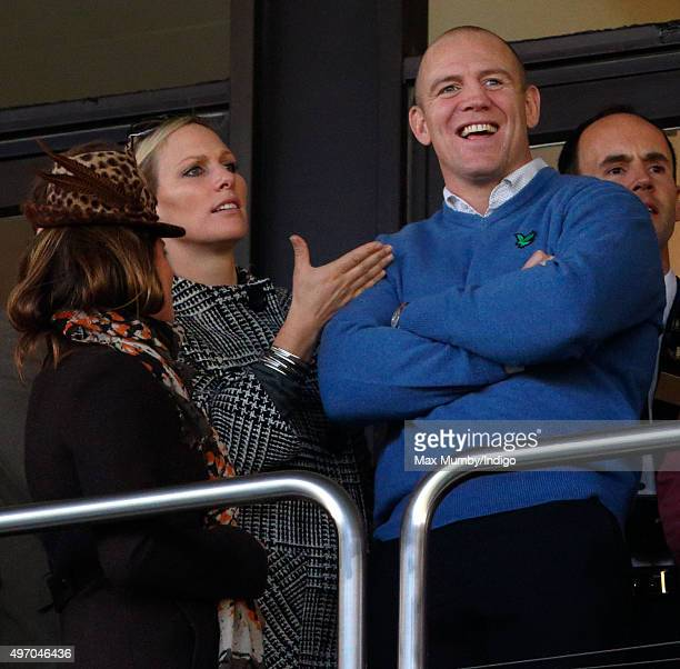 Dolly Maude Zara Phillips and Mike Tindall watch the racing as they attend Countryside Day of The Open meeting at Cheltenham Racecourse on November...