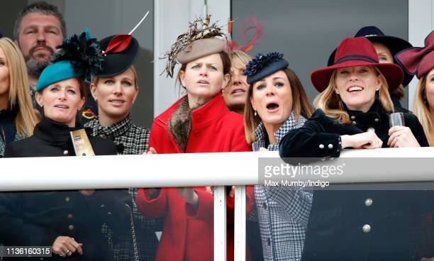 Dolly Maude Zara Tindall Natalie Pinkham and Autumn Phillips watch the racing as they attend day 4 'Gold Cup Day' of the Cheltenham Festival at...