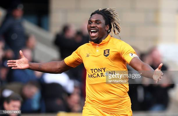 Dolly Menga of Livingston FC celebrates after scoring his team's first goal during the Ladbrokes Premiership match between Livingston and Rangers at...