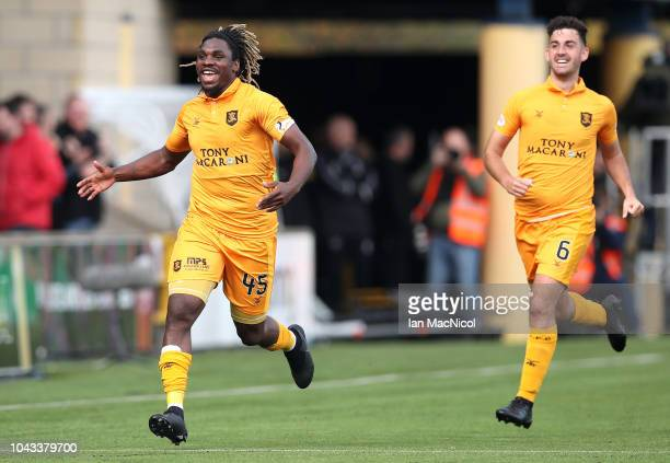 Dolly Menga of Livingston FC celebrates with team mate Shaun Byrne after scoring his team's first goal during the Ladbrokes Premiership match between...