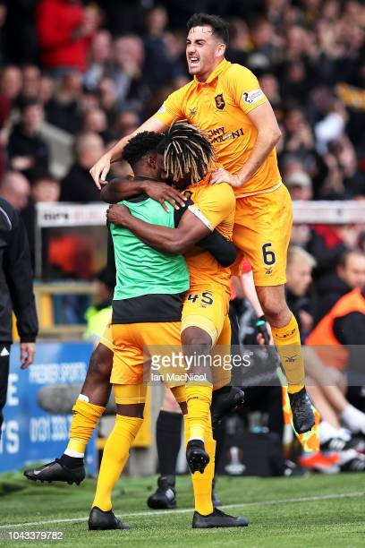Dolly Menga of Livingston FC celebrates with team mates after scoring his team's first goal during the Ladbrokes Premiership match between Livingston...