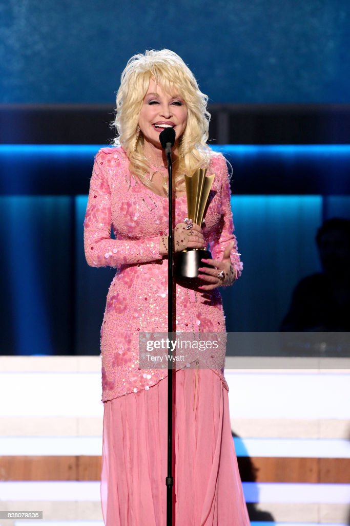 Dolly Parton accepts the Gary Haber Lifting Lives Award onstage during the 11th Annual ACM Honors at the Ryman Auditorium on August 23, 2017 in Nashville, Tennessee.