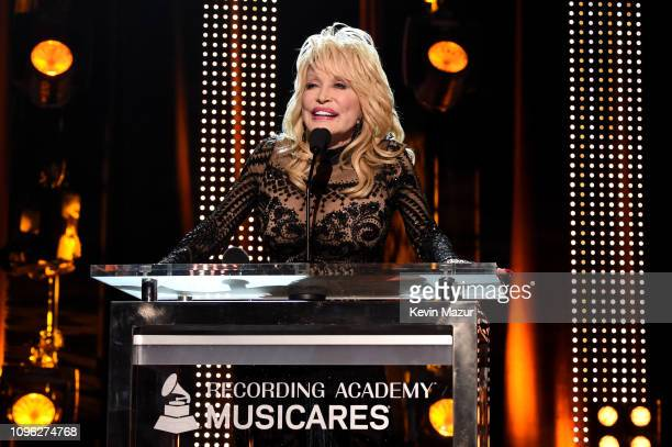 Dolly Parton accepts the MusiCares Person of the Year award onstage during MusiCares Person of the Year honoring Dolly Parton at Los Angeles...