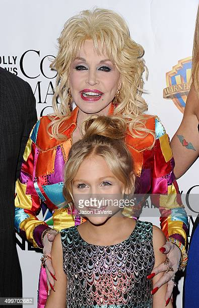 Dolly Parton and Alyvia Alyn Lind attend the premiere of Dolly Parton's Coat Of Many Colors at the Egyptian Theatre on December 2 2015 in Hollywood...