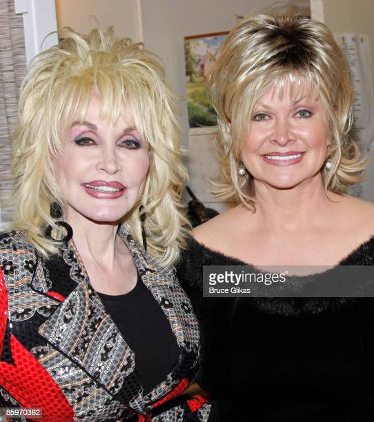 Dolly Parton and her sister Rachel Parton Dennison pose backstage at the hit new musical 9 to 5 on Broadway at The Marquis Theatre on April 13 2009...