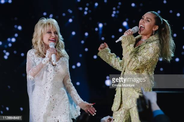 Dolly Parton and Miley Cyrus perform onstage at the 61st annual GRAMMY Awards at Staples Center on February 10 2019 in Los Angeles California