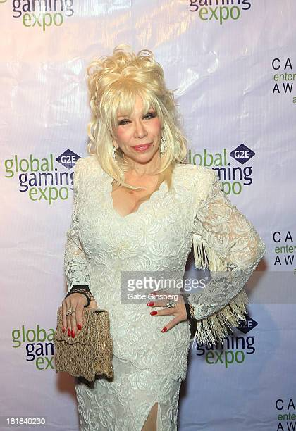 Dolly Parton impersonator C J Morgan arrives at the Casino Entertainment Awards at G2E at the Plaza Hotel Casino on September 25 2013 in Las Vegas...