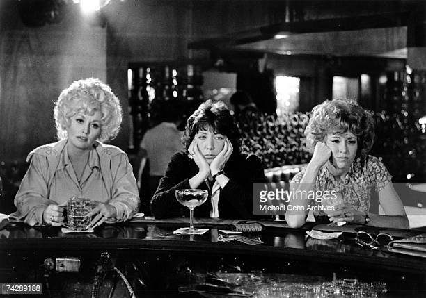 Dolly Parton Lily Tomlin and Jane Fonda acts in a scene from the movie 9 to 5 which was released on December 19 1980