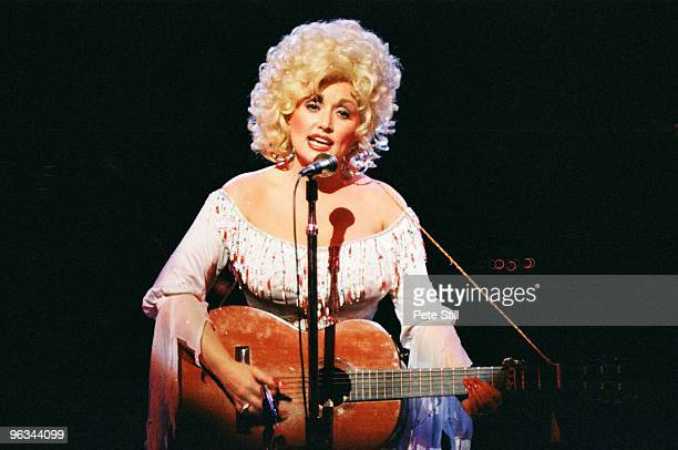 Dolly Parton performs on stage at The Dominion Theatre on March 29th, 1983 in London, United Kingdom.