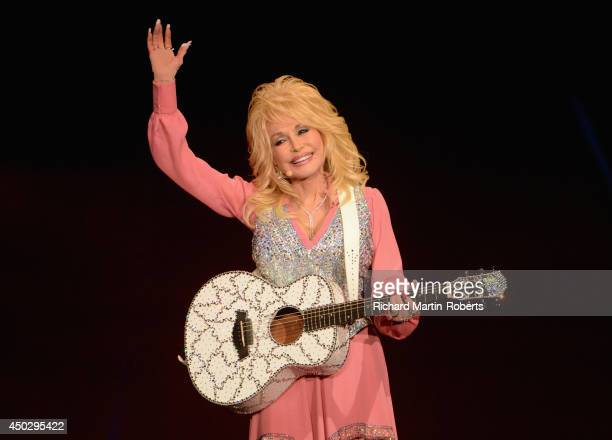 Dolly Parton performs on stage at the Echo Arena on June 8 2014 in Liverpool United Kingdom