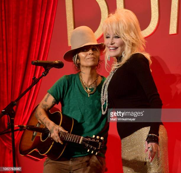 Dolly Parton performs onstage with Linda Perry at a luncheon for the Netflix Film Dumplin' at Four Seasons Hotel Los Angeles at Beverly Hills on...