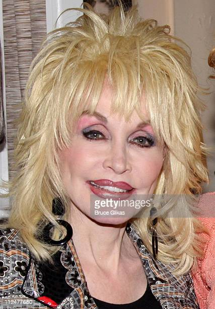 Dolly Parton poses backstage at the hit new musical 9 to 5 on Broadway at The Marquis Theatre on April 13 2009 in New York City