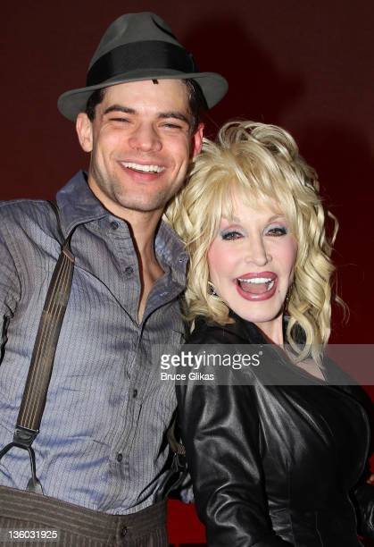 Dolly Parton poses backstage with cast member Jeremy Jordan at the musical Bonnie and Clyde on Broadway at The Gerald Schoenfeld Theatre on December...