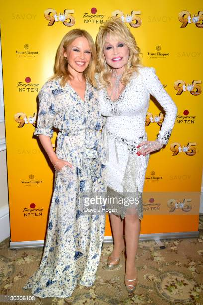 Dolly Parton poses with Kylie Minogue as she visits The Cast of '9 To 5' The Musical at The Savoy Theatre on February 17 2019 in London England