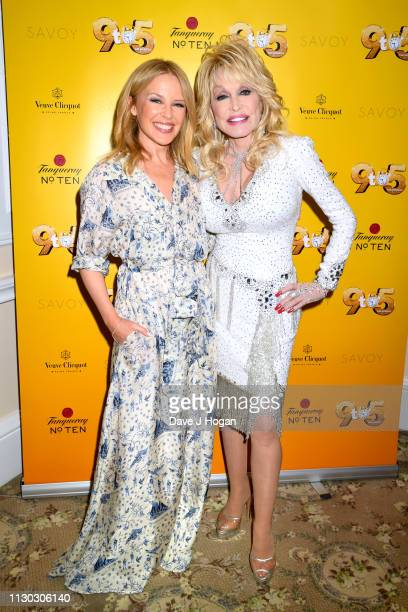 Dolly Parton poses with Kylie Minogue as she visits The Cast of 9 To 5 The Musical at The Savoy Theatre on February 17 2019 in London England