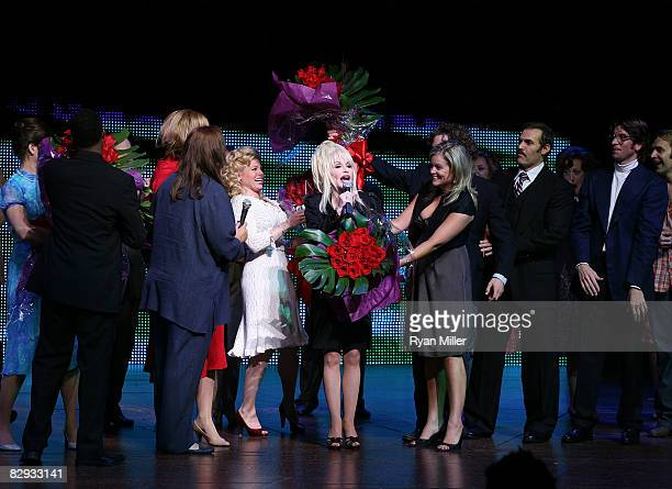 Dolly Parton recieves flowers during the curtain call for the world premiere of of 9 to 5 The Musical at Center Theatre Group's Ahmanson Theatre on...