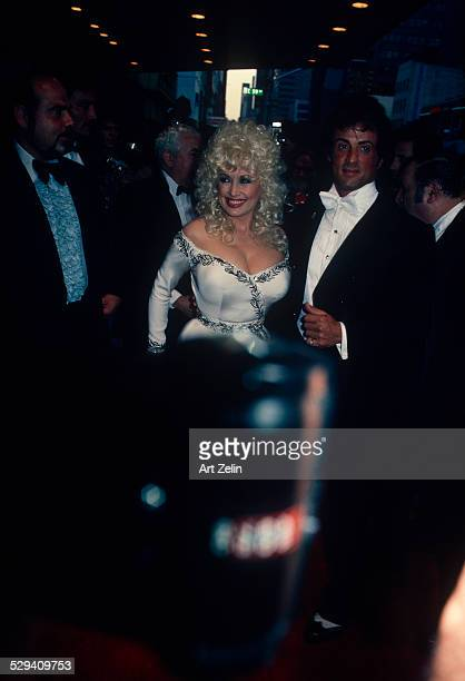 Dolly Parton Sylvester Stallone She is wearing a white beaded formal dress circa 1970 New York