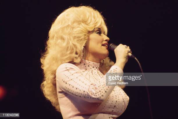 Dolly Parton US country singersongwriter singing into a microphone during a live concert performance at the Wembley Empire Pool London England Great...