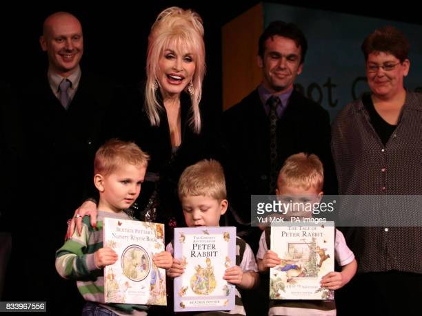Dolly Parton with children from Rotherham Jack Boden aged 3 and twins Jake and Josh Devey aged 4 at the launch of her Imagination Library of the...
