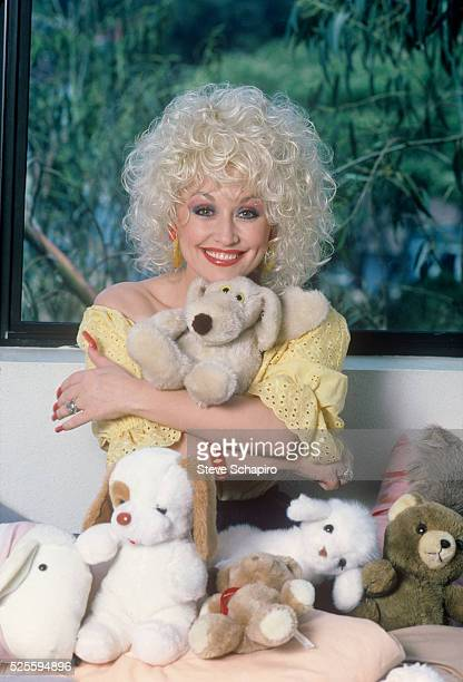 Dolly Parton with stuffed animals