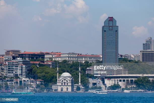 dolmabahçe mosque and the süzer plaza in istanbul - gwengoat stock pictures, royalty-free photos & images