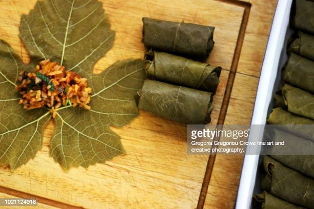 dolmathakia - stuffed grape leaves with rice and herbs - gregoria gregoriou crowe fine art and creative photography. stock pictures, royalty-free photos & images