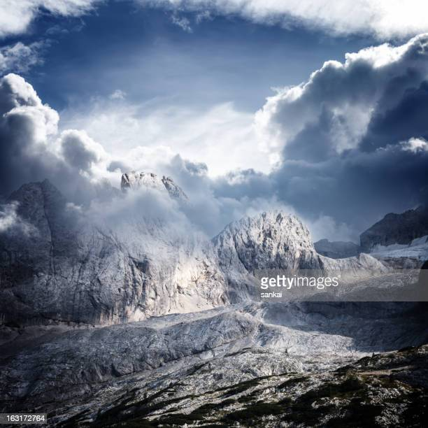 Dolomites mountain ridge in clouds