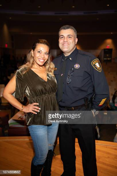 Dolores Catania and brother Lt Louis Spagnola attend the Cesar DJ Envy's 2018 Holiday Toy Giveaway on December 21 2018 in Paterson New Jersey